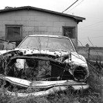 junk_car_in_grass